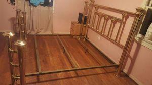Gold metal king bed frame for Sale in Alexandria, VA