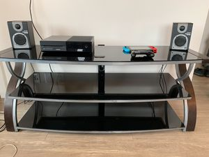Black glass entertainment stand for Sale in Austin, TX
