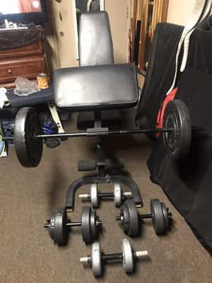 ADJUSTABLE WEIGHT CURL BENCH and DUMBBELLS and BAR is 4ft LONG and 100 LBS PLATES for Sale in East Los Angeles, CA