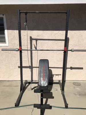 Squat rack with pulley and bench, curl bar, and cable attachments for Sale in Glendora, CA