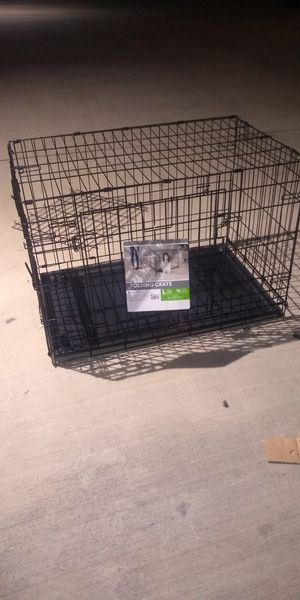 You and me folding dog crate with divider large 36 by 23 by 24 for Sale in Austin, TX