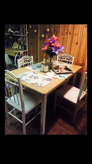 Table with four chairs and microwave Shelf for Sale in St. Louis, MO