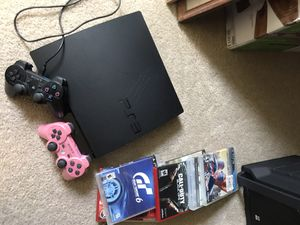 PS3 with 2 controllers and multiple games for Sale in Madera, CA