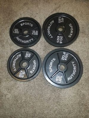 Olympic weights. Pair of 45s and 35s. 160lbs. for Sale in Deerfield Beach, FL