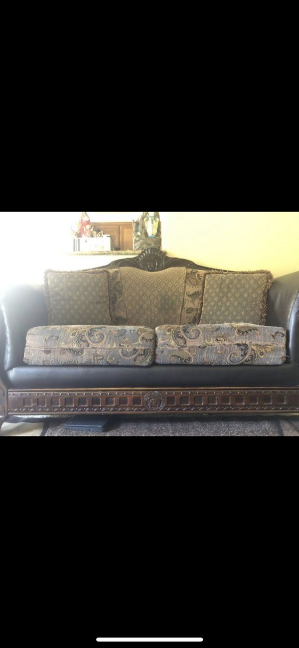 2 Versace couches and big rug