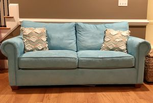Teal blue couch for Sale in Clayton, NC