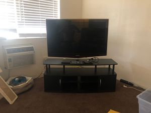 TV with Entertainment stand for Sale in Fullerton, CA
