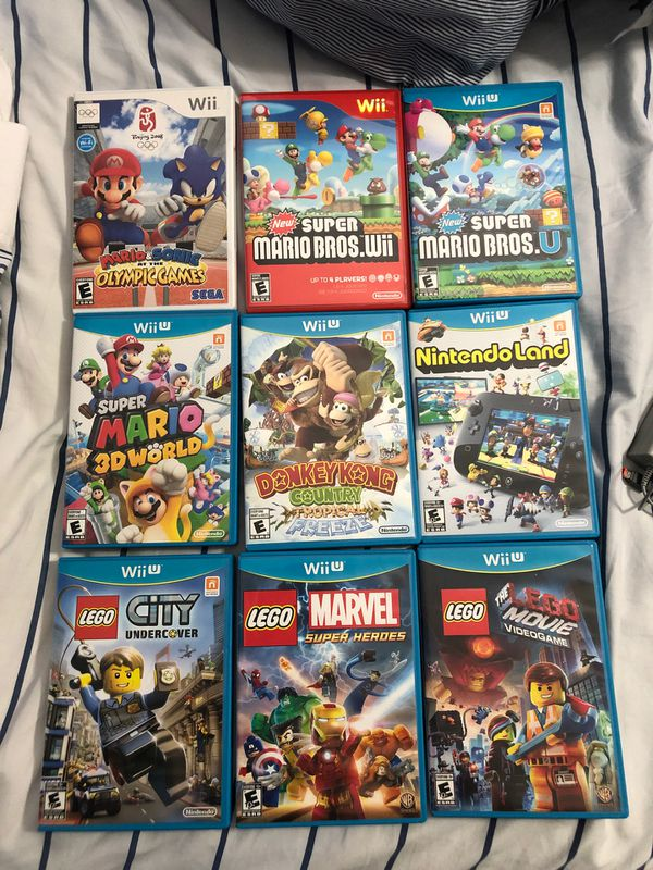 Wii U with 10 games, 2 controllers, charging dock & chords