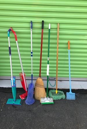 Misc lot of brooms mops and dusters for Sale in Herndon, VA