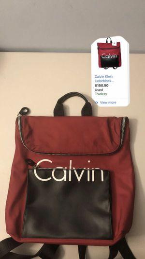 Used Calvin Klein Red Black Color block Backpack men's women's for Sale in Centreville, VA