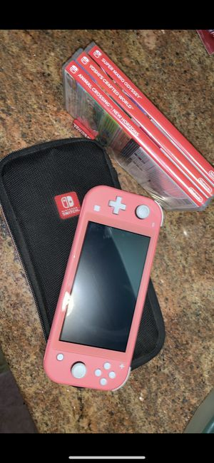 Nintendo Switch Lite Coral for Sale in Spanaway, WA