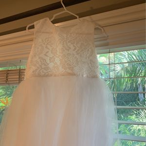 Flower girl dress never used brand new size 6/small Smoke free home includes blue flower and belt sash for Sale in Claremont, CA