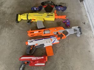 Lot of Nerf/Fortnite play guns and face protection for Sale in Bedford, TX