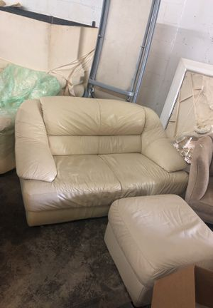 2 cream leather couches and foot stool for Sale in Miami, FL
