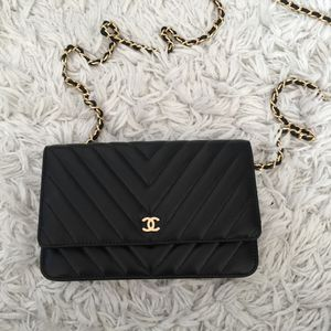 Authentic Chanel black leather WOC crossbody bag for Sale in New York, NY