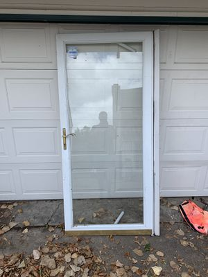 Single glass pane with metal border storm door for Sale in Dallas, TX