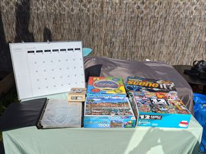 Puzzles games dry erase calendar couponer book for Sale in Pasadena, CA