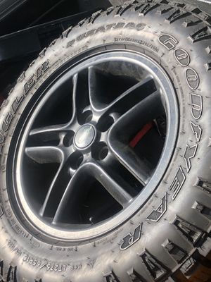 """Land Rover 18"""" inch wheel / rim in good condition and a brand NEW Goodyear Wrangler Duratrac 275/65R18 tire - ONLY $80 obo for Sale in Orlando, FL"""