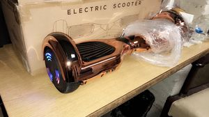 Rose gold Bluetooth self balance wheel hover board for Sale in Chicago, IL