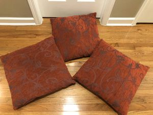 """Set of 3 Throw Decorative Couch Pillows in a deep red color with Scroll leaf detail. Pillows are 21""""x21"""" and in used condition. $5 for all 3 cash at for Sale in Apex, NC"""