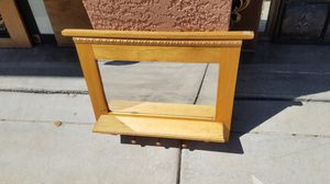 Wall hanging mirror with hooks for Sale in Modesto, CA