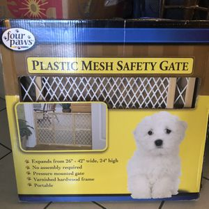 Four Paws Plastic/ Wood Mesh Safety Gate for Sale in Hialeah, FL