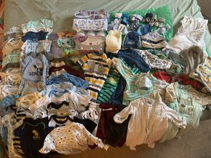 Baby boy clothes 0-3 and newborn and includes newborn diaper opened box only a couple missing 104 ct pampers for Sale in Sully Station, VA