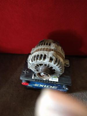 Used parts alternator and battery fits most chevy GMC and buick with 5.3l or 6.o engines for Sale in Chicago, IL