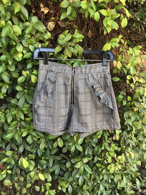 Small black and white plaid shorts for Sale in Riverside, CA