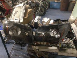 Toyota 4 runner black housing headlights 04 05 for Sale in Beachwood, NJ