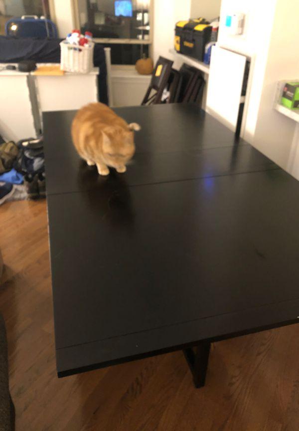 Folding black wood dining table