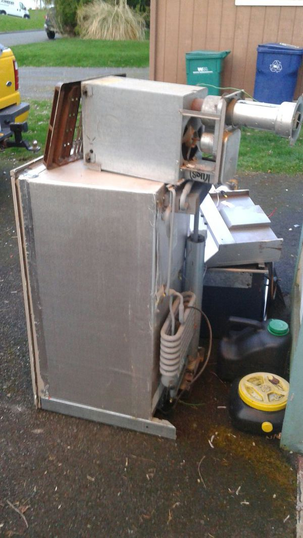 3 way camping fridge, propane heater(sold), propane stove, oven, battery operated stove fan and stainless steel sink. All for camp trailer