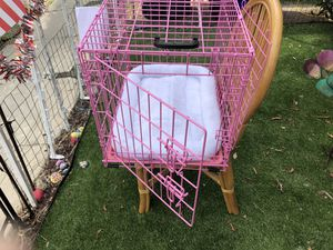 Pink dog crate 24 inches long 17 inches wide 18 inches for Sale in San Diego, CA