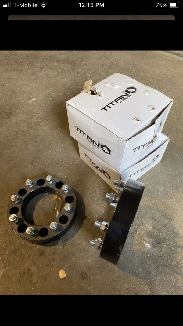 Four wheel spacers for skid steer