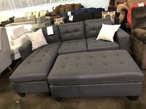 Reversible fabric sectional with ottoman. Brand new. for Sale in Grand Prairie, TX