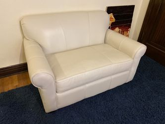 White leather single pull out couch bed. for Sale in Denver,  CO