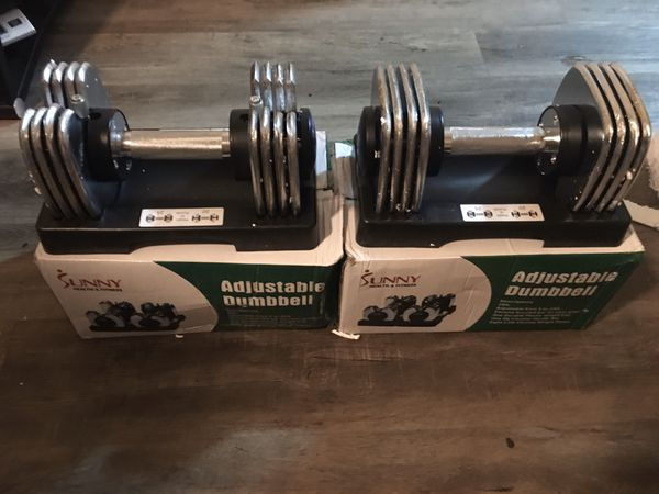Adjustable dumbells set from 5 to 25 new in box
