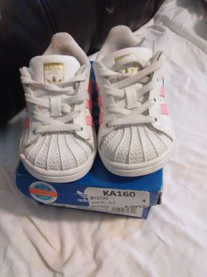 Adidas baby shoes size 4 for Sale in St. Louis, MO