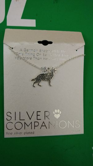 Silver Charm of a dog w chain for Sale in Malden, MA