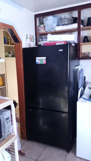 All black fridge with freezer on bottom. Not apt size for Sale in Barstow, CA