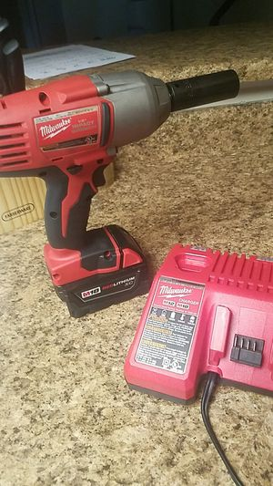 Milwaukee impact wrench with charger for Sale in Las Vegas, NV