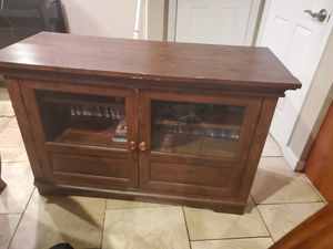 Tv stand with glass doors for Sale in Seattle, WA