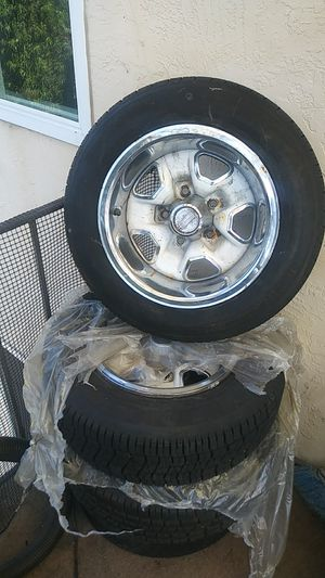 14 inch stock rims and tire for a Oldsmobile Cutlass complete with beauty ringsOBO for Sale in Hayward, CA