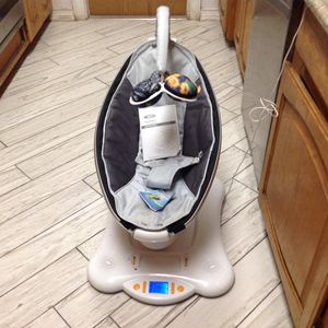 4Moms Mamaroo infant cradle swing plays music moves up and down only $35 for Sale in Tempe, AZ