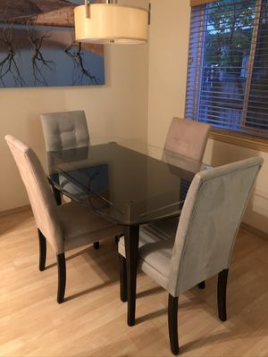 Glass dining table with 4 chairs (Ashley Furniture). Chairs are beige (2) and light blue(2). for Sale in Seattle, WA