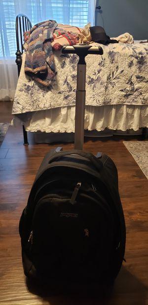 Jansport Black rolling backpack. for Sale in Houston, TX