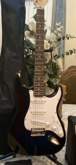 black huntington electric guitar with case cable strap and amp for Sale in Downey,  CA