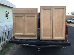 Two new kitchen cabinets Right (34'tall, 27' wide,24' deep) Left (36' tall, 27' wide, 12' deep) for Sale in Glendale, AZ