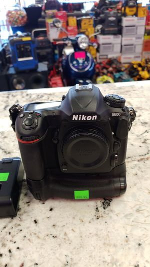 Nikon D500 Digital Camera Body with 2 Batteries, charger and bottom mount piece for Sale in San Bernardino, CA