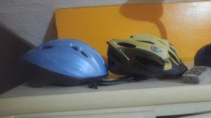 Kid Schwinn Bike helmet & Free adult light blue helmet for Sale in Cleveland, OH